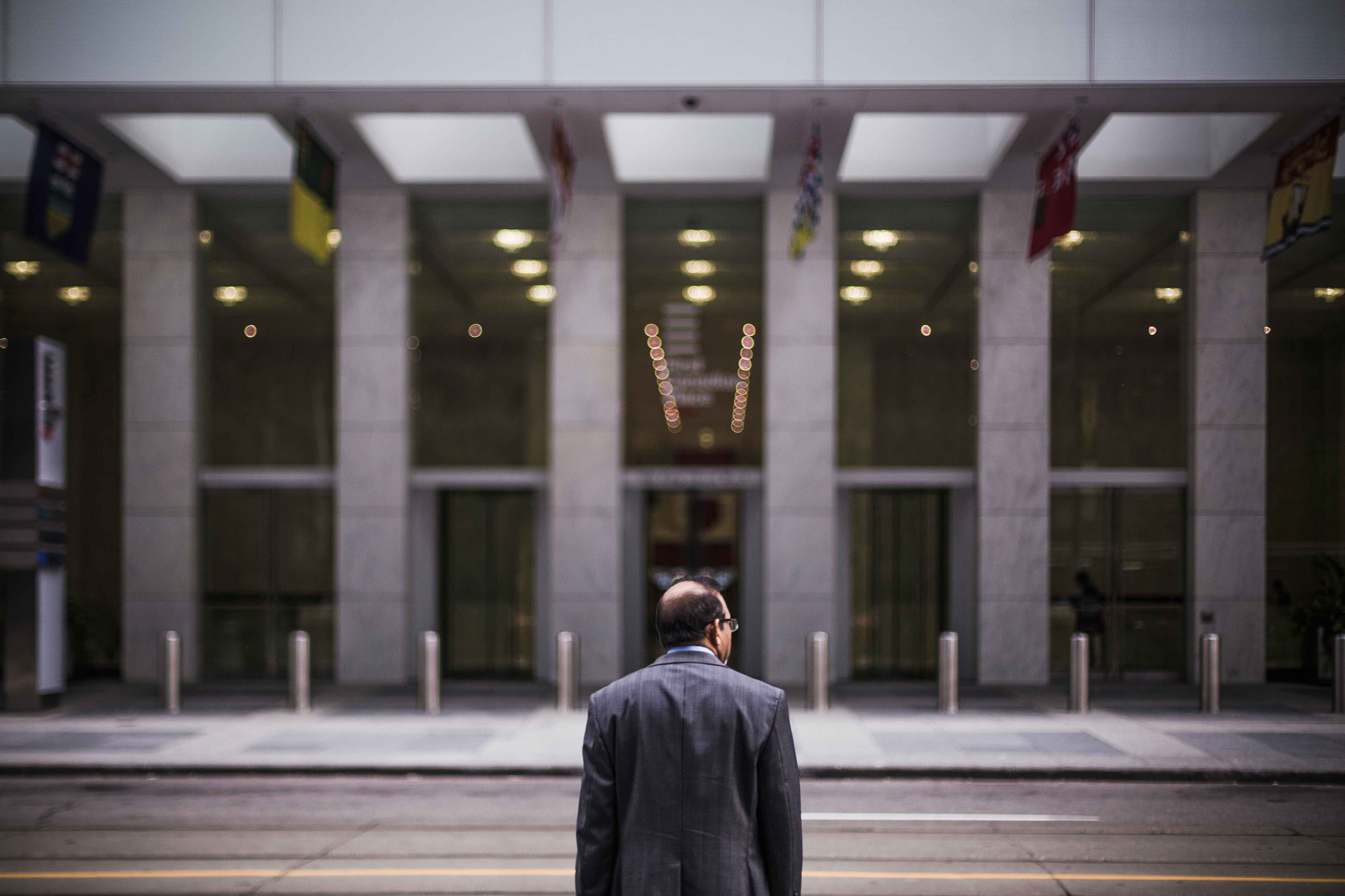 man at office building